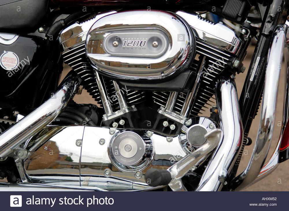 close-up-of-a-v-twin-engine-of-a-harley-davidson-sportster-1200-custom-AHXM52.thumb.jpg.4cf42f68e9d789fdfb19be79e05fdee0.jpg