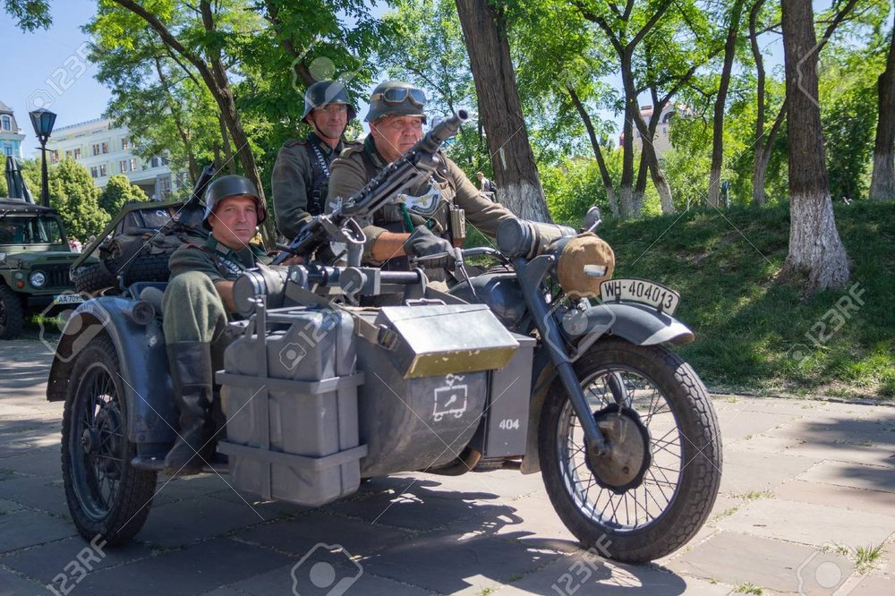 106714782-kiev-ukraine-may-27-2018-mens-in-the-form-of-wehrmacht-soldiers-from-world-war-ii-on-a-motorcycle-at (1).jpg